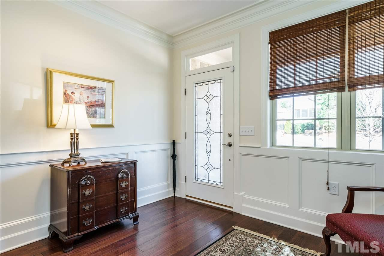 Three large windows fill the Foyer with natural light.