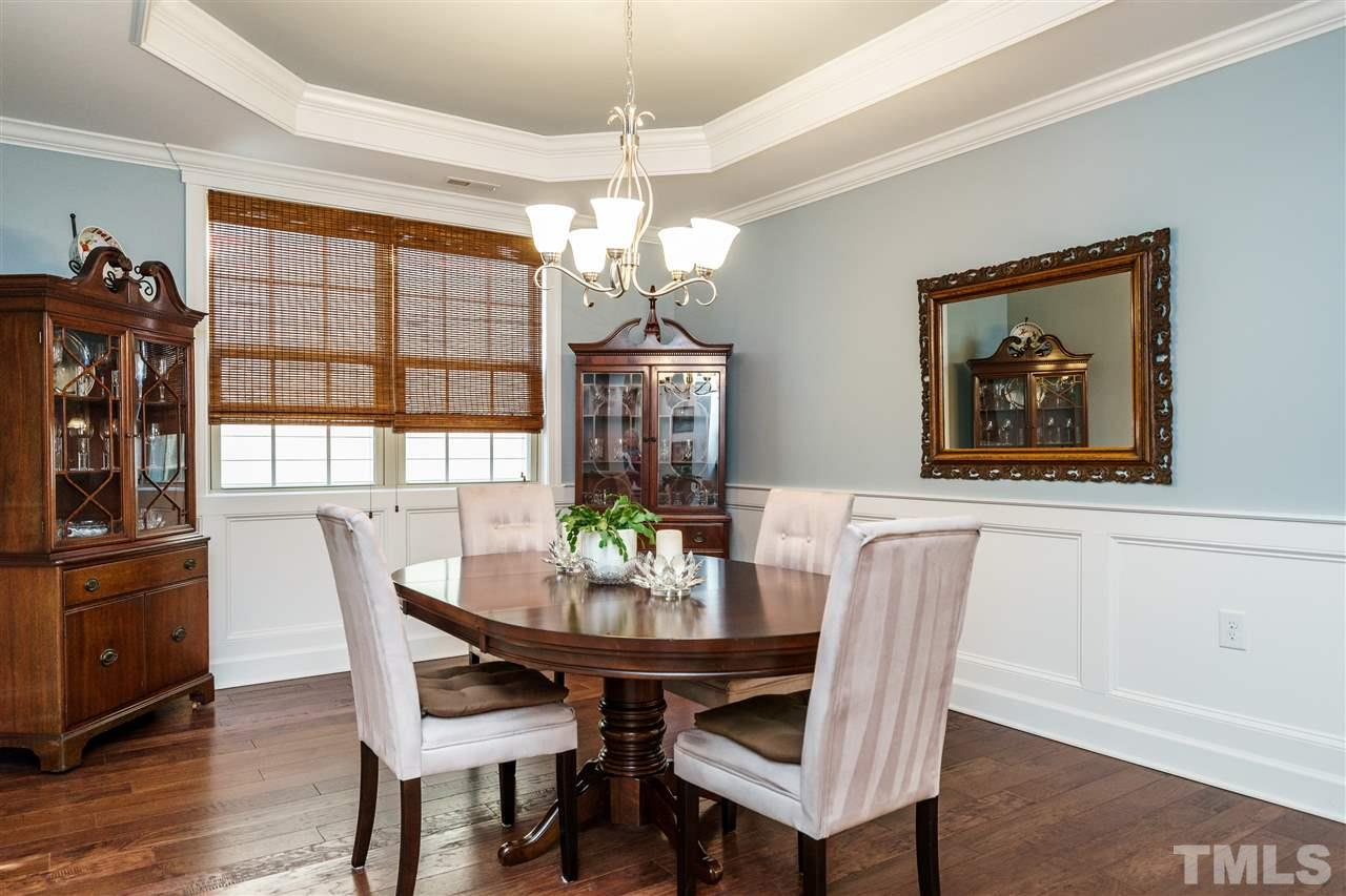 Elegance comes to mind when you see the detailed trim, columns, the painted tray ceiling and the beautiful engineered hardwoods.