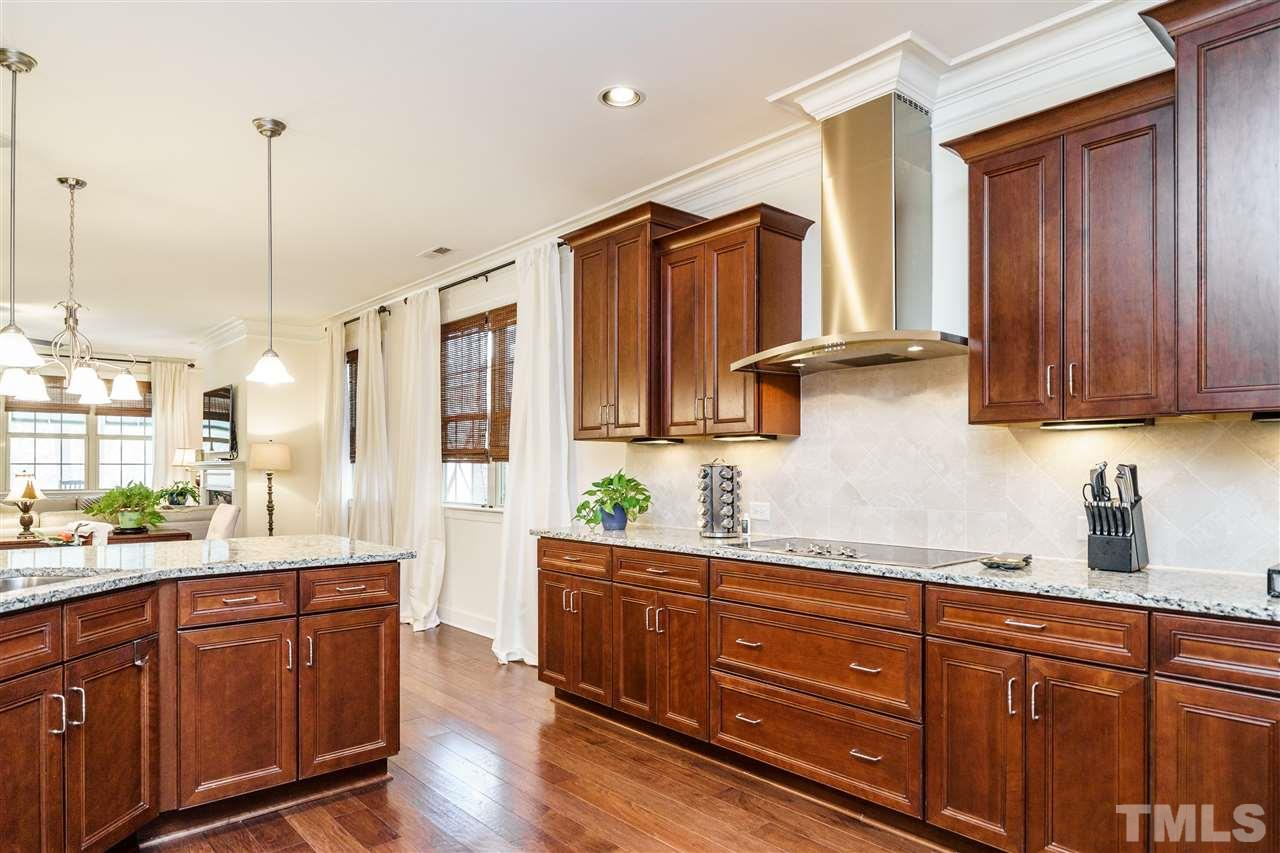 The Kitchen is right there yet hidden from the dinner guests with a wonderful wall of cabinets.