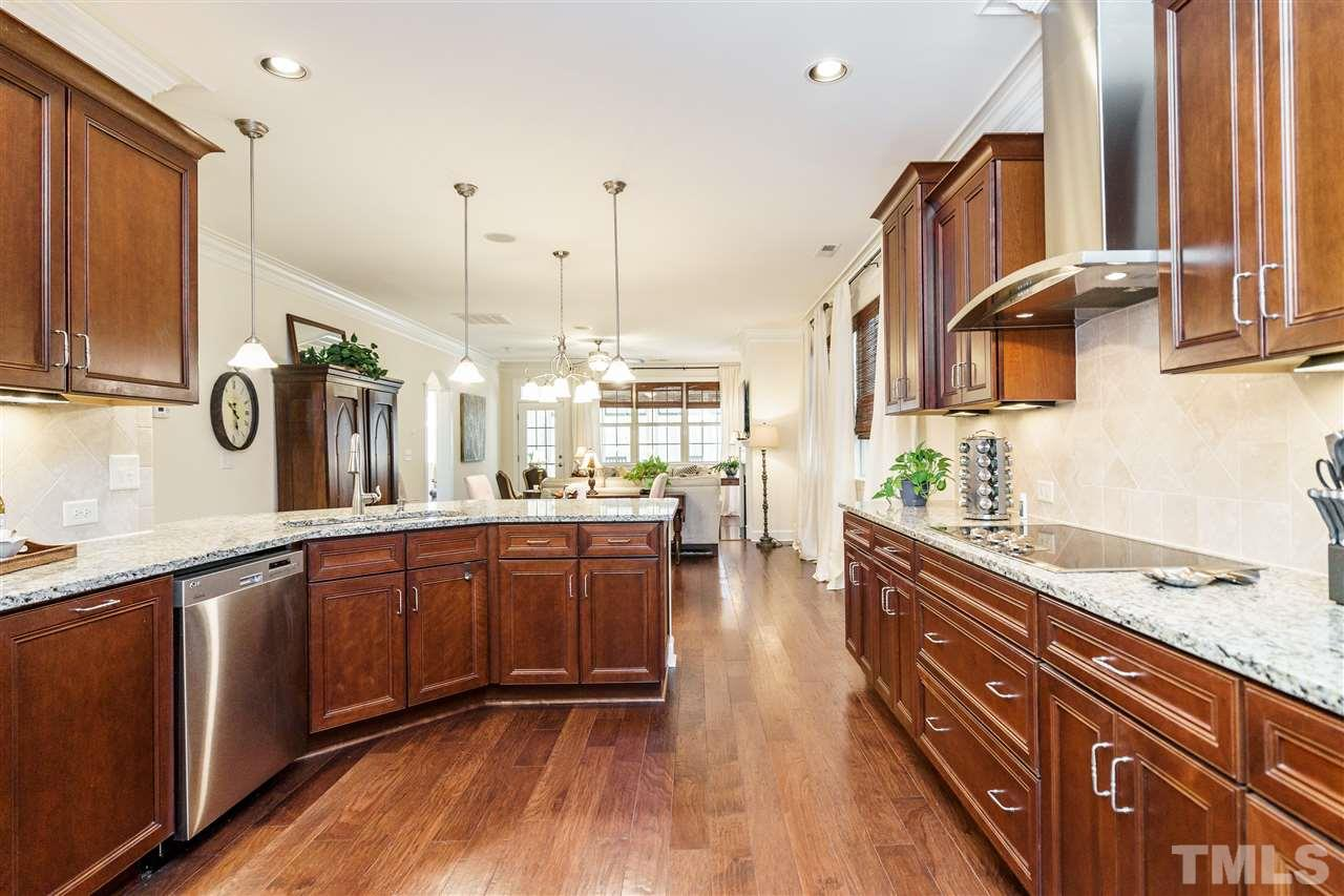 WOW!  Premium SS appliances with features all will enjoy using along with those beautiful cabinets with finished, trimmed sides, under lighting, and the self closing feature.  Extra can lighting as well!