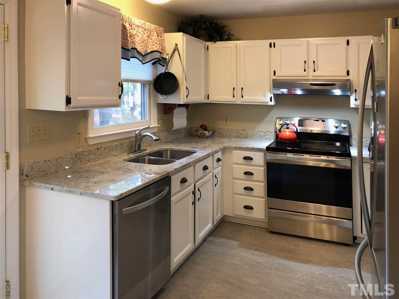 Kitchen recently renovated with granite countertops. Stainless steel appliances and Marmoleum eco friendly flooring.
