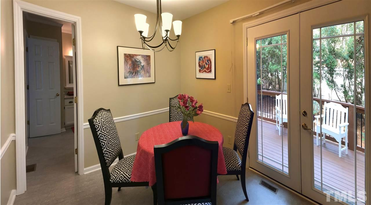 Breakfast area has French doors that lead to deck and walk in pantry is on opposite wall.