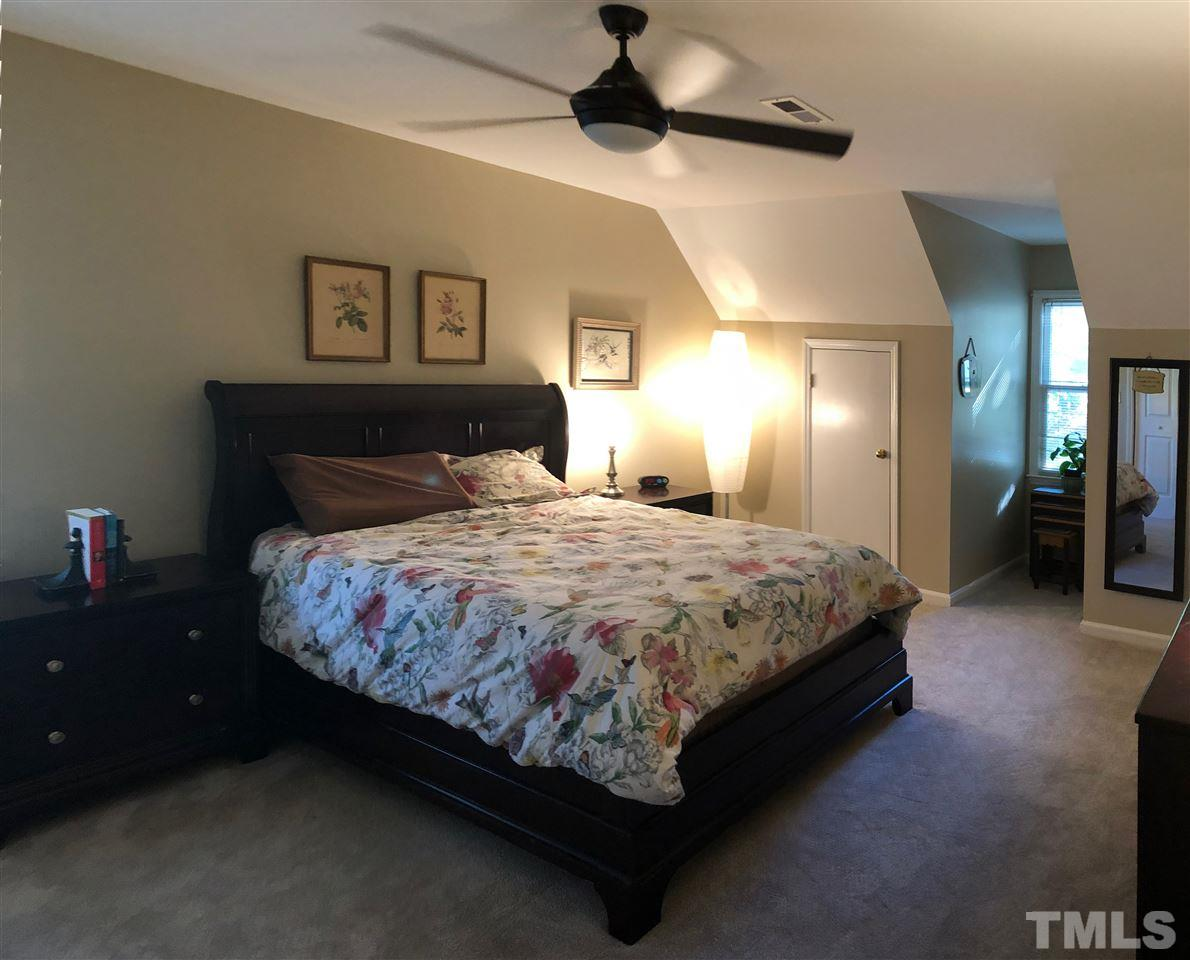 Second bedroom has lighted ceiling fan, dormer storage as well as generous closet space.