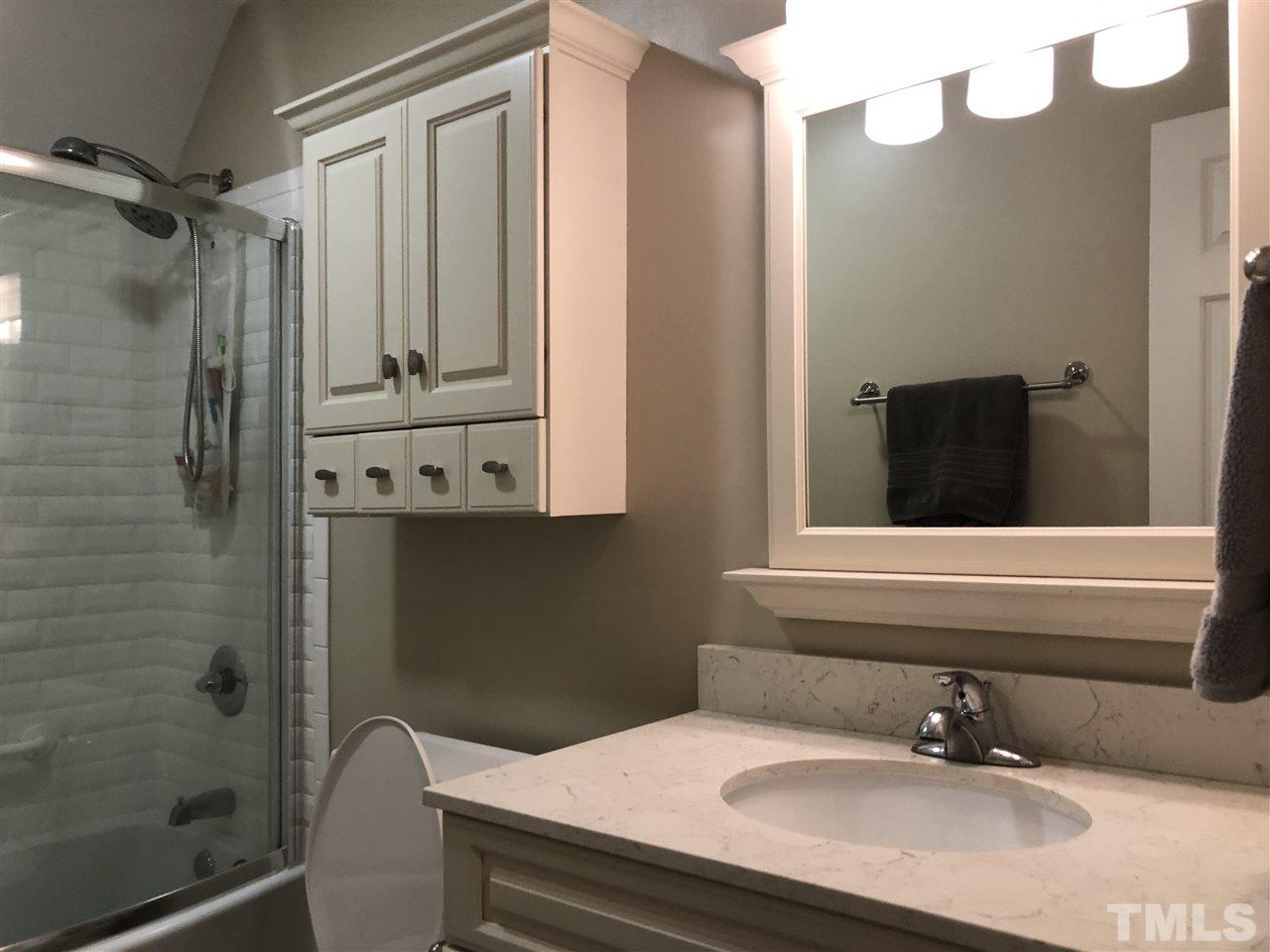 Upstairs bathroom updated with new countertop and mirror.