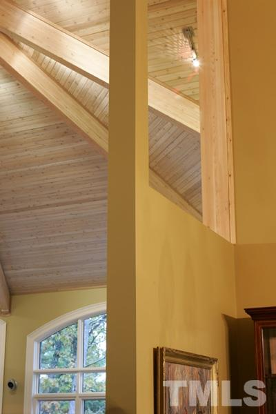 Beatutiful beamed ceilings in main living areas.