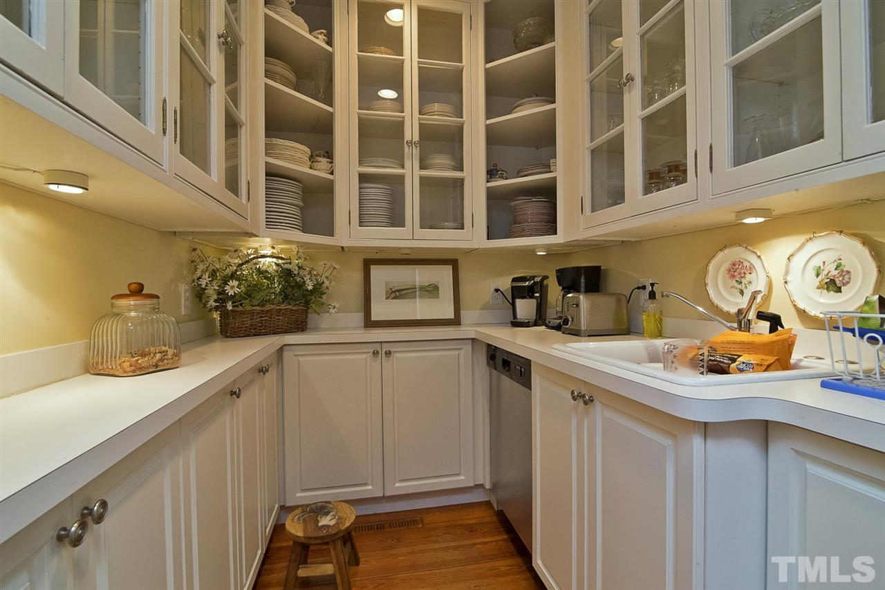 Perfect spot for storing crystal, china, serving pieces and silverware. This room is complete with dishwasher, making it a great catering kitchen for those special at-home events.
