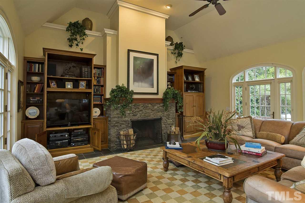 Cathedral ceilings, gas fireplace and surround sound make for the perfect entertaining space.