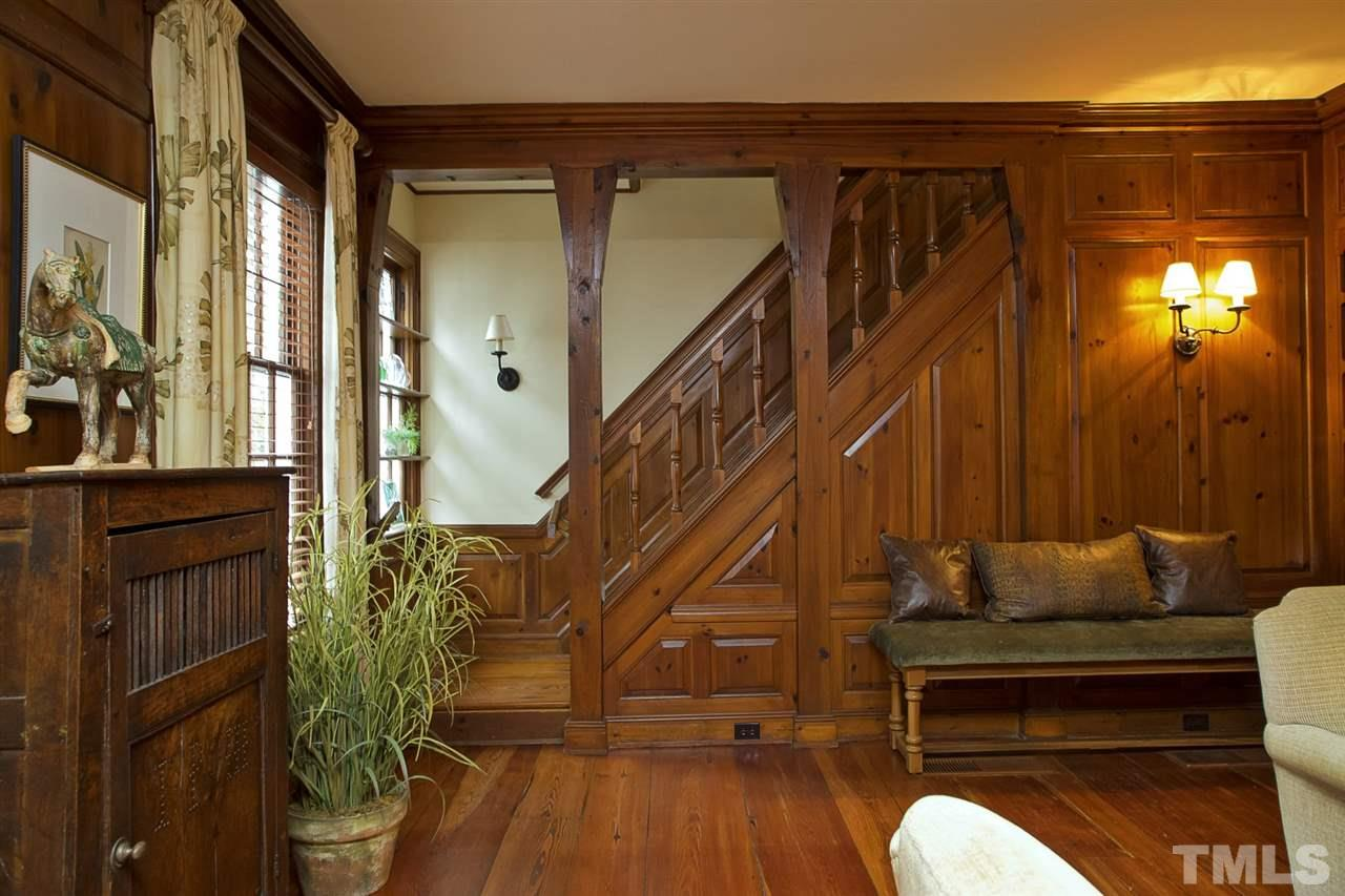 Original pine paneled walls and handcrafted stairway.
