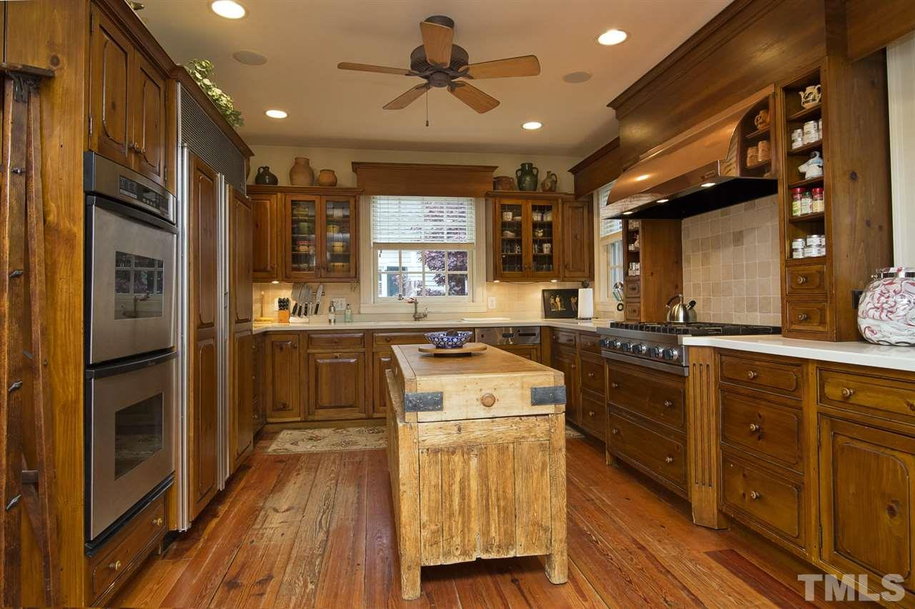 Warm wood cabinetry and double ovens serve up an inviting kitchen.