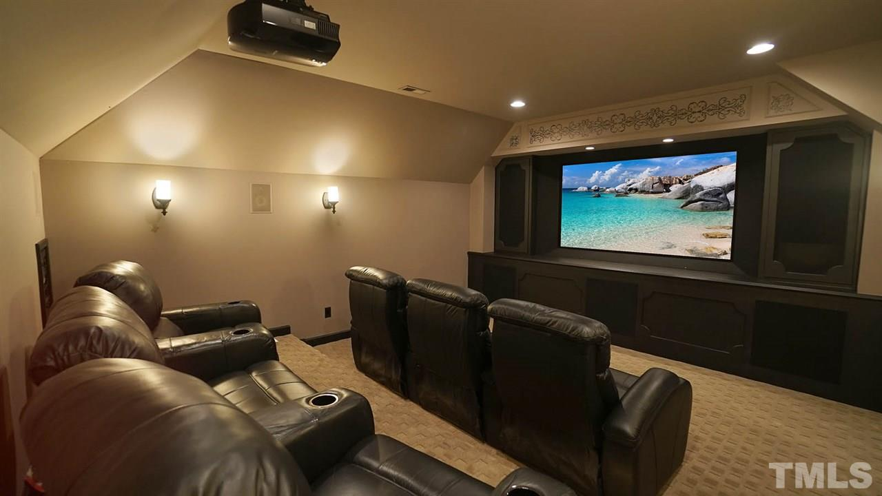 Private screening room, w/ oversized screen, projector and audio equipment.  Leather theatre seating.