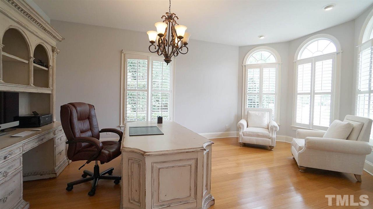 Huge office (or formal living room), light filled with plantation shutters and bamboo flooring,