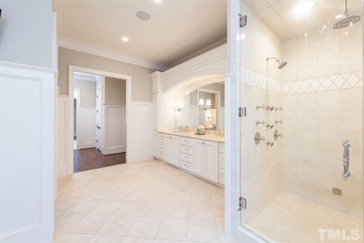 Large tile floor, 6ft moldings, vintage fixtures on lady's vanity, huge walk in shower w/ built in bench, rain soak shower head & additional body sprays & hand held