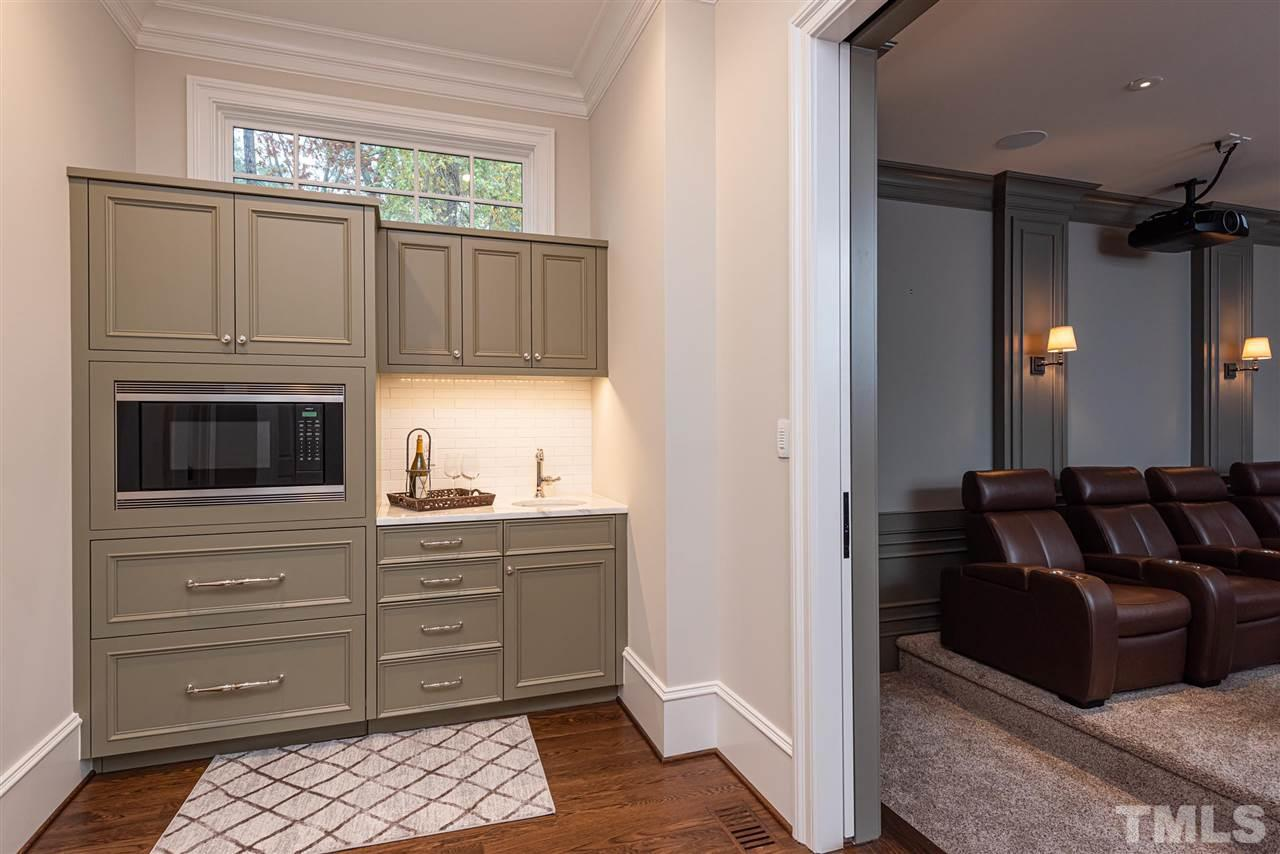 Take the privatse stairs to your personal home office.  Built in desks, room for a conference area, hardwood fl. Recessed can lighting, & room to expand w/unfinished space across the hall