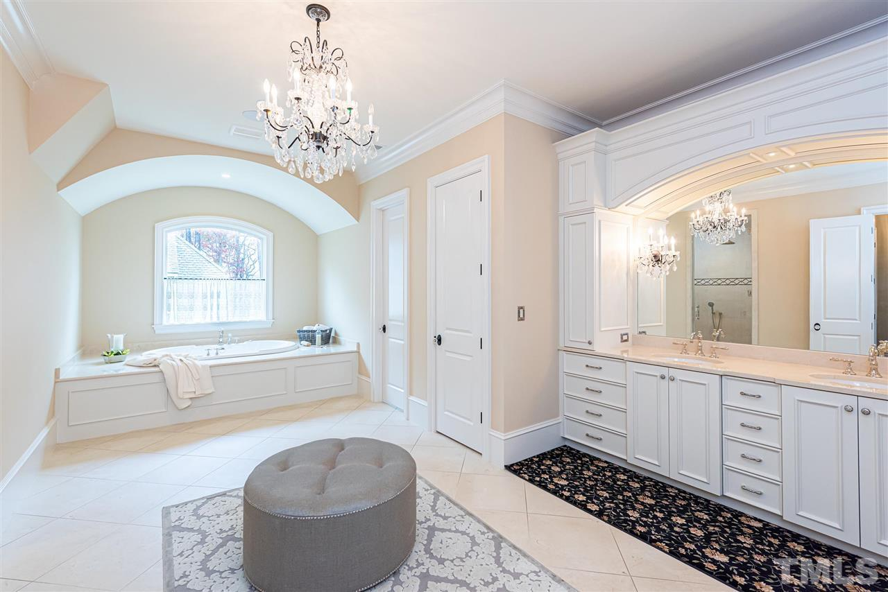 Oversized master bath spa retreat.  Double vanities, tons of storage, & garden whirlpool tub.  Crystal chandelier