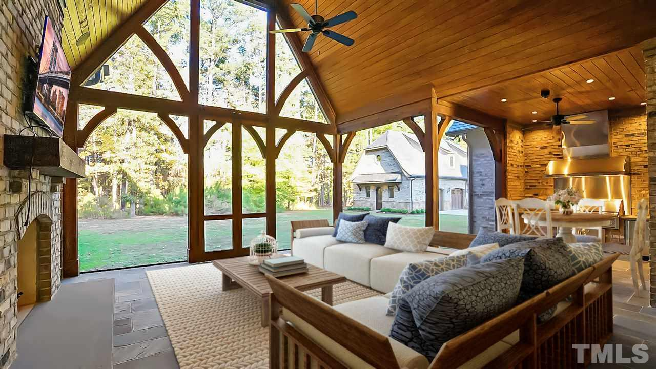 "Huge living & outdoor dining area. Built in SSfridge, range hood, & 54"" Lynx Grill. Flagstone floor, vaulted ceilings, & sliding barn doors. Wood burning fireplace, stone hearth, & stained wood shiplap ceilings, recessed lighting & built in speakers"