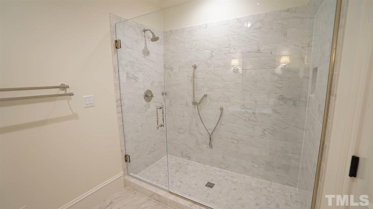 All bathrooms appointed with finishes typically found in master bathrooms.  Light, spa feeling, each guest bedroom has it's own ensuite bathroom & walk in closet