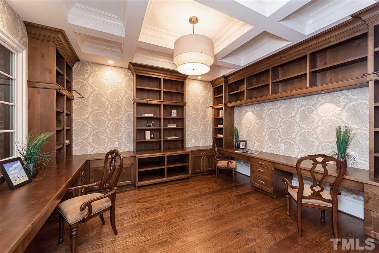 Perfect spot for kids homework, office & storage area.  Built in custom cabinetry, pocket doors, & art lighting