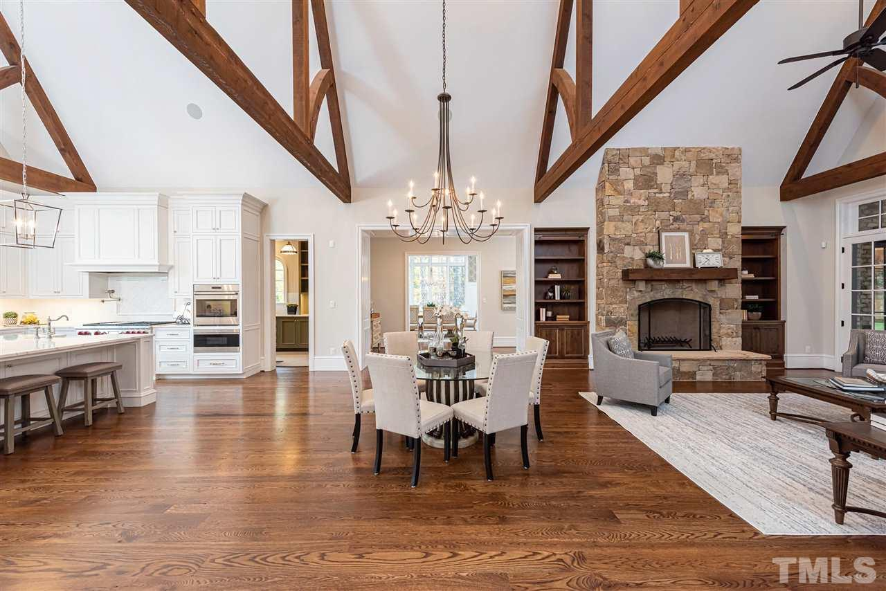Main house family room w/ massive wood beams & vaulted ceiling, complete open fl plan. Built ins w/ custom art lighting, beautiful stone fireplace, perfect blend of stained wood w/light painted cabinets & counters for a luxury inviting feel