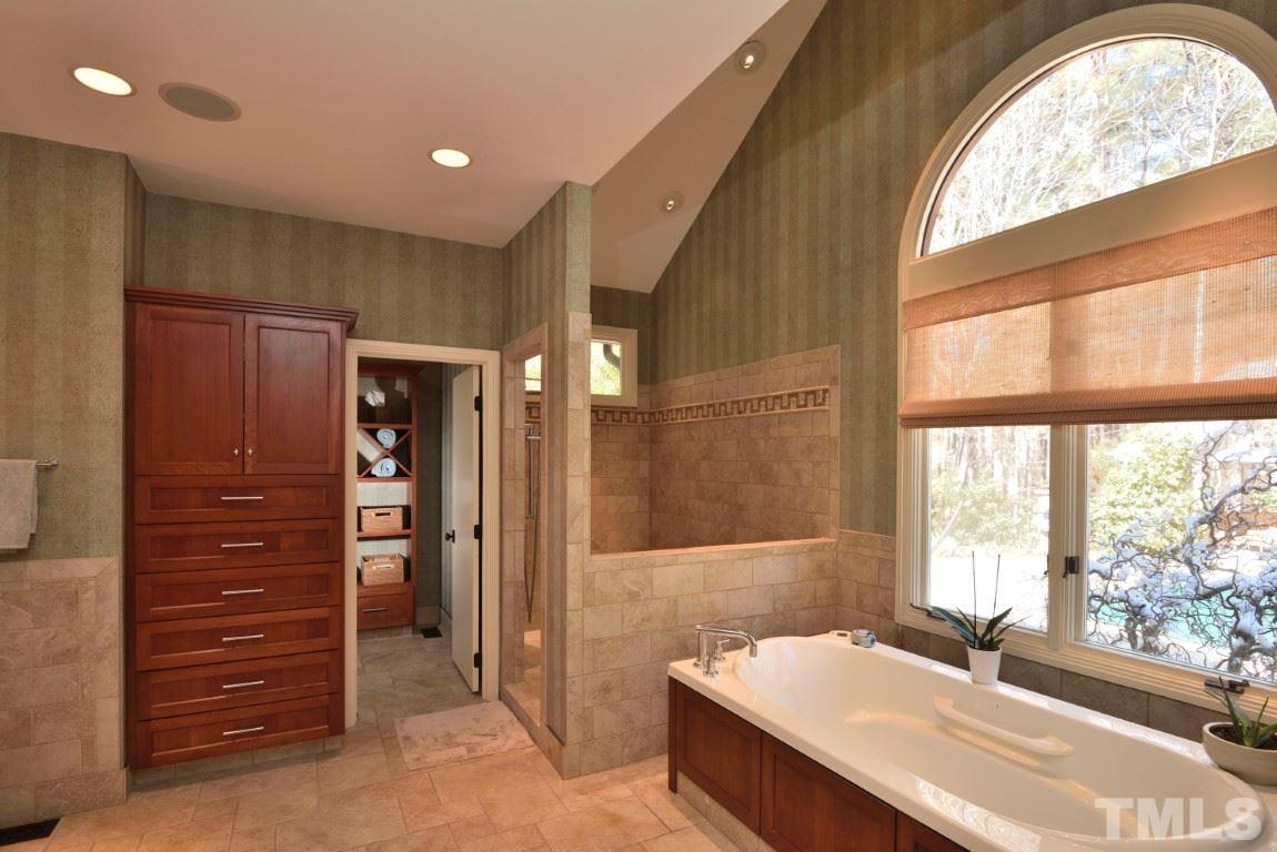 Renovated master bath with cherry cabinets and heated tile floors