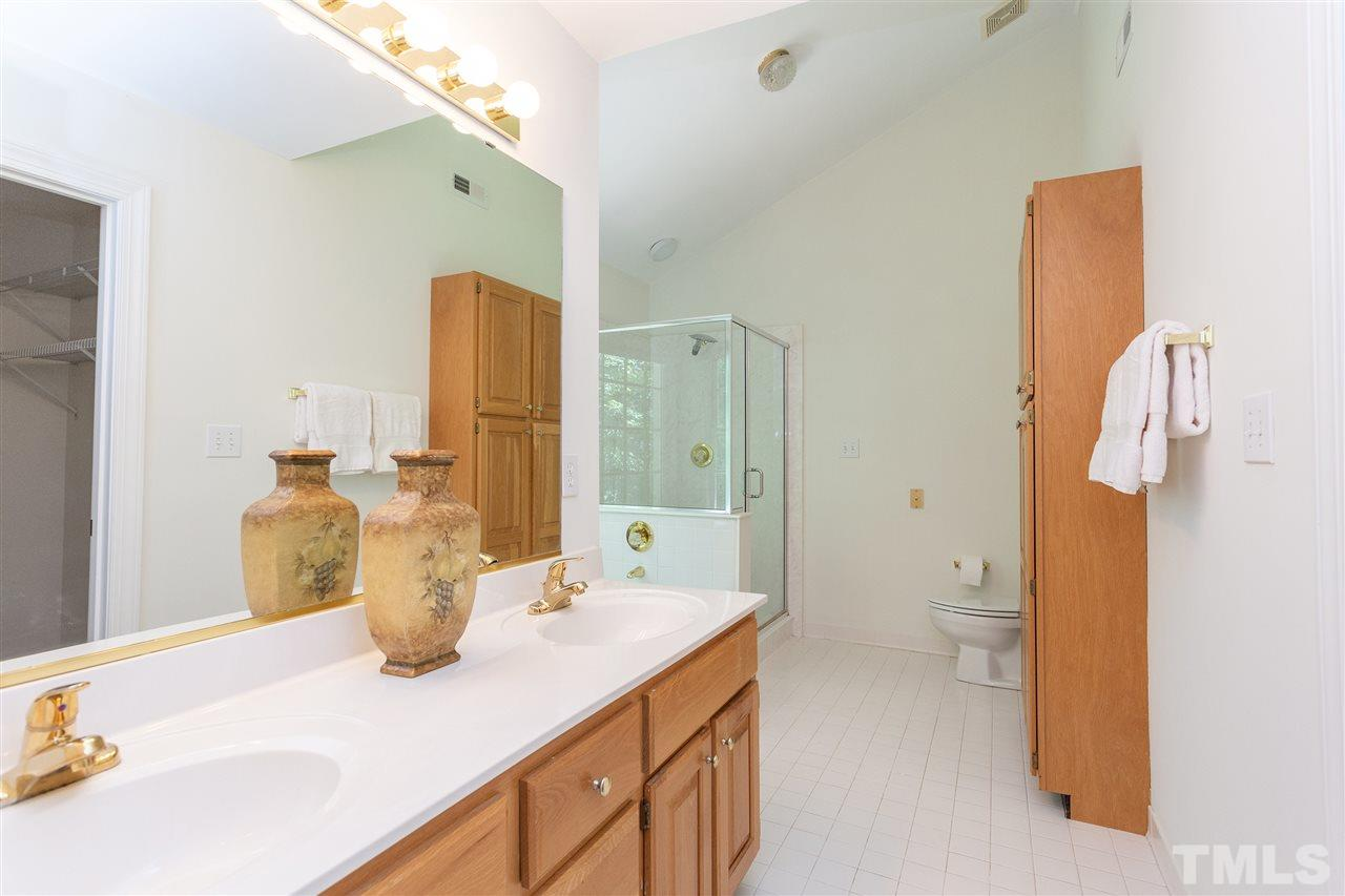 Enjoy walk-in shower with large whirlpool tub overlooking private backyard.