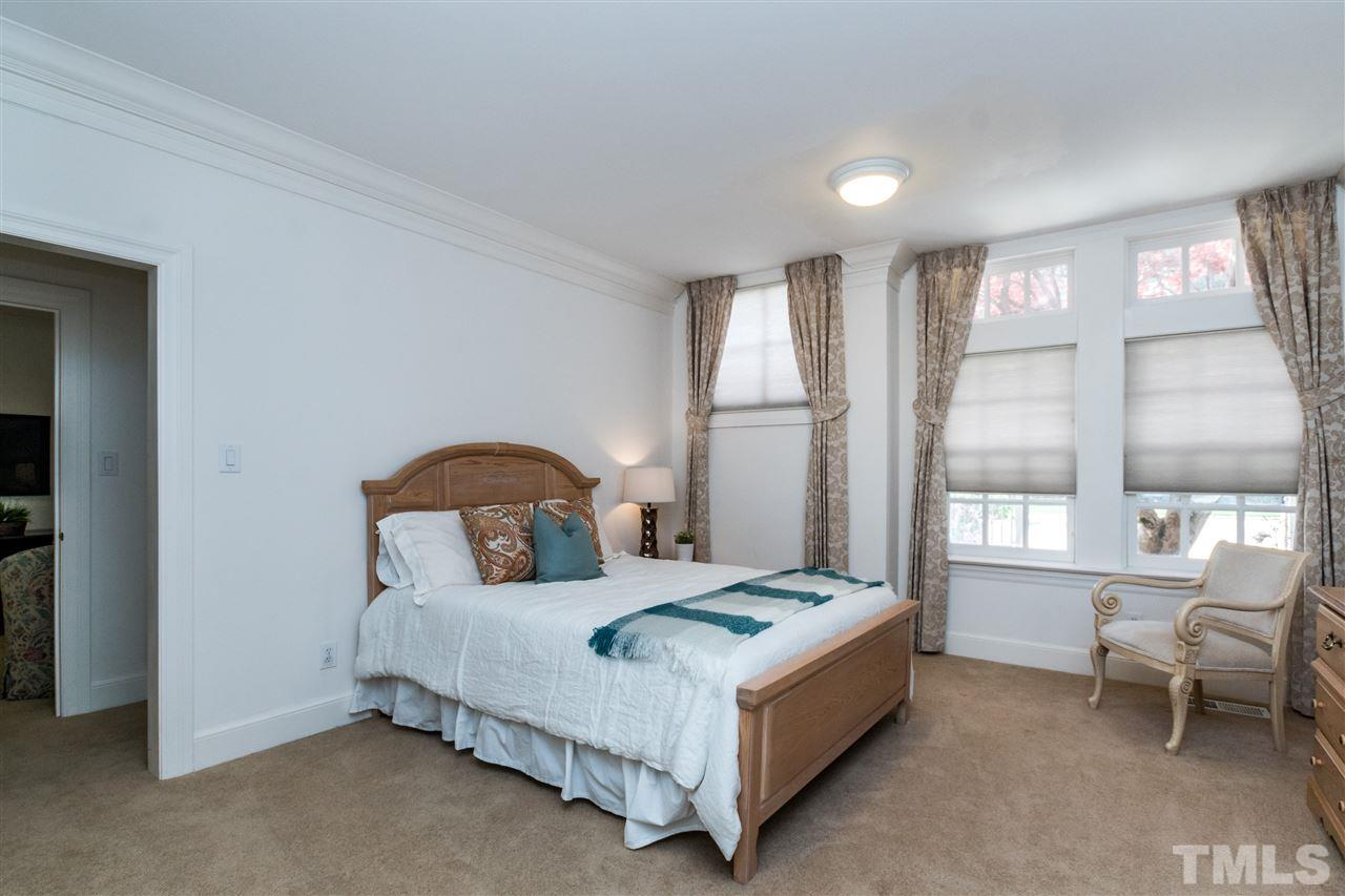 First floor in-law/nanny/guest suite with adjacent sitting room and bath with walk in shower. Easy access to kitchen and laundry, this is the perfect place for family or in home care givers.