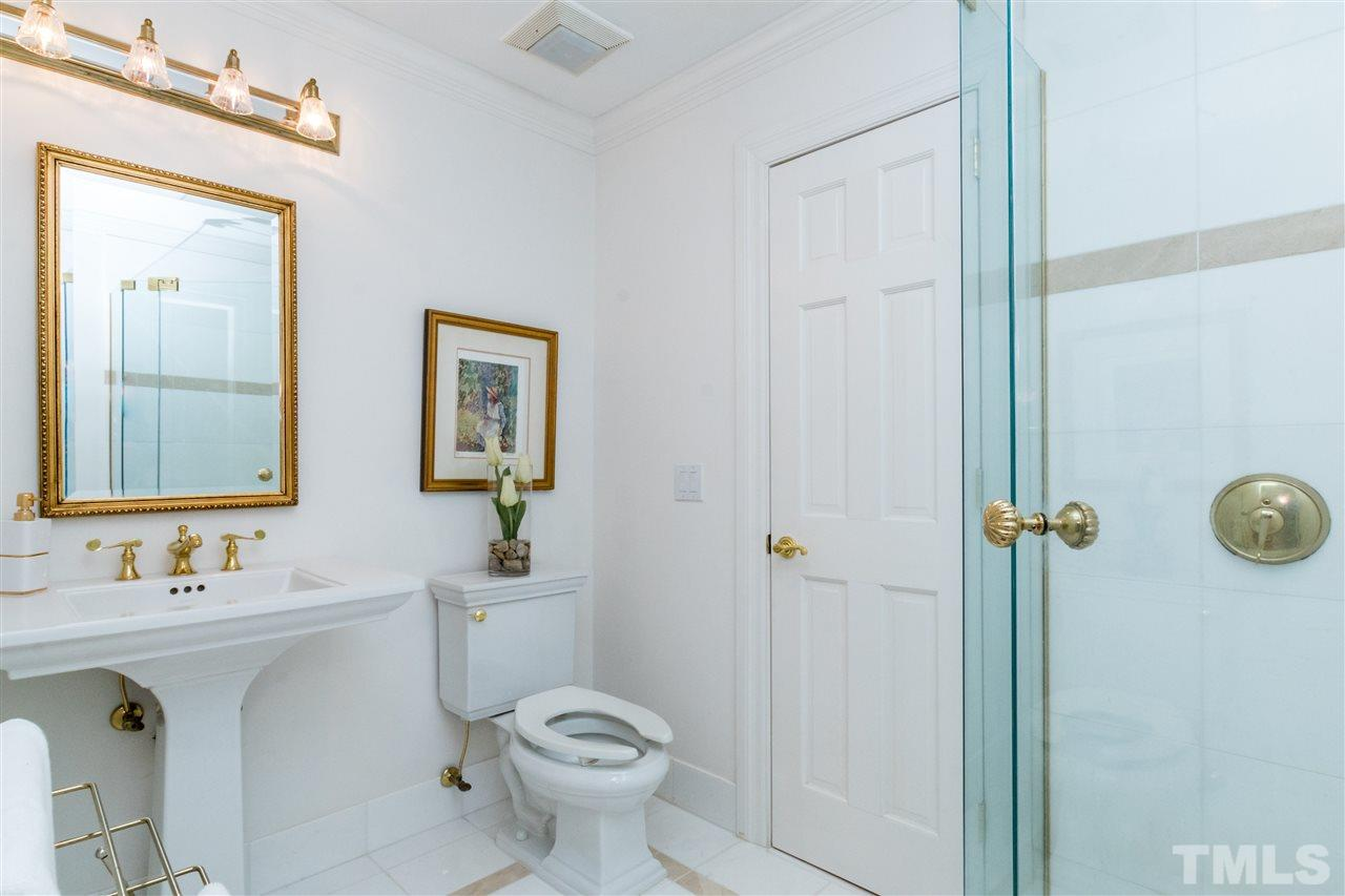 First floor secondary bath features marble surround walk in shower.