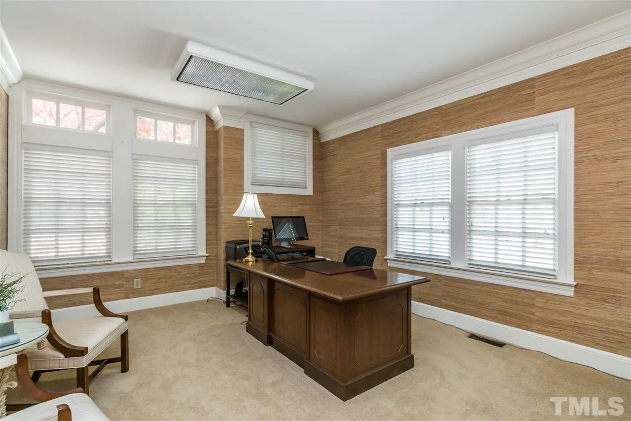 Secondary office features original gorgeous grasscloth wallpaper and large windows.