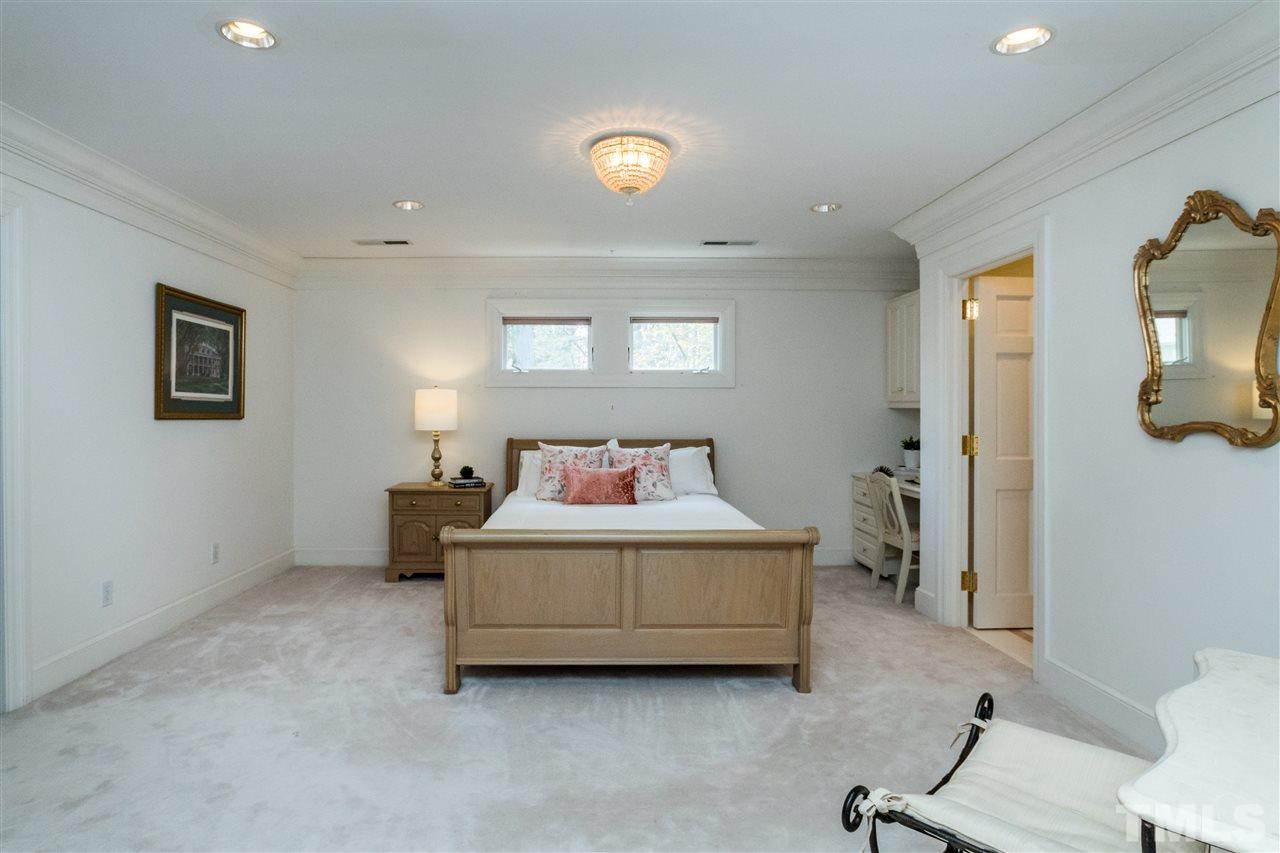 Huge upstairs bedroom with massive walk in closet, en suite marble bath with jetted tub and dual sinks. Ideal secondary master or teen suite.