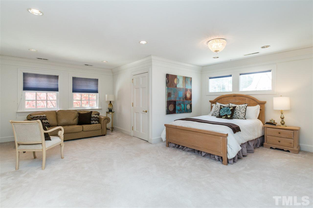 Upstairs large secondary bedroom with sitting area, 2 walk in closets and en suite marble bath with jetted tub.