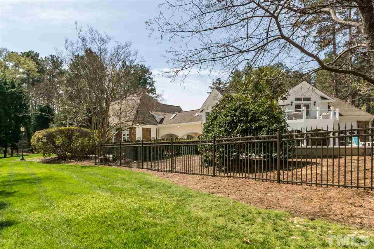 Large lot features lots of rear privacy. 1.73 acres in an amazing Cary location. Adjacent parcel beyond pool is buildable for expansion, or guest house.