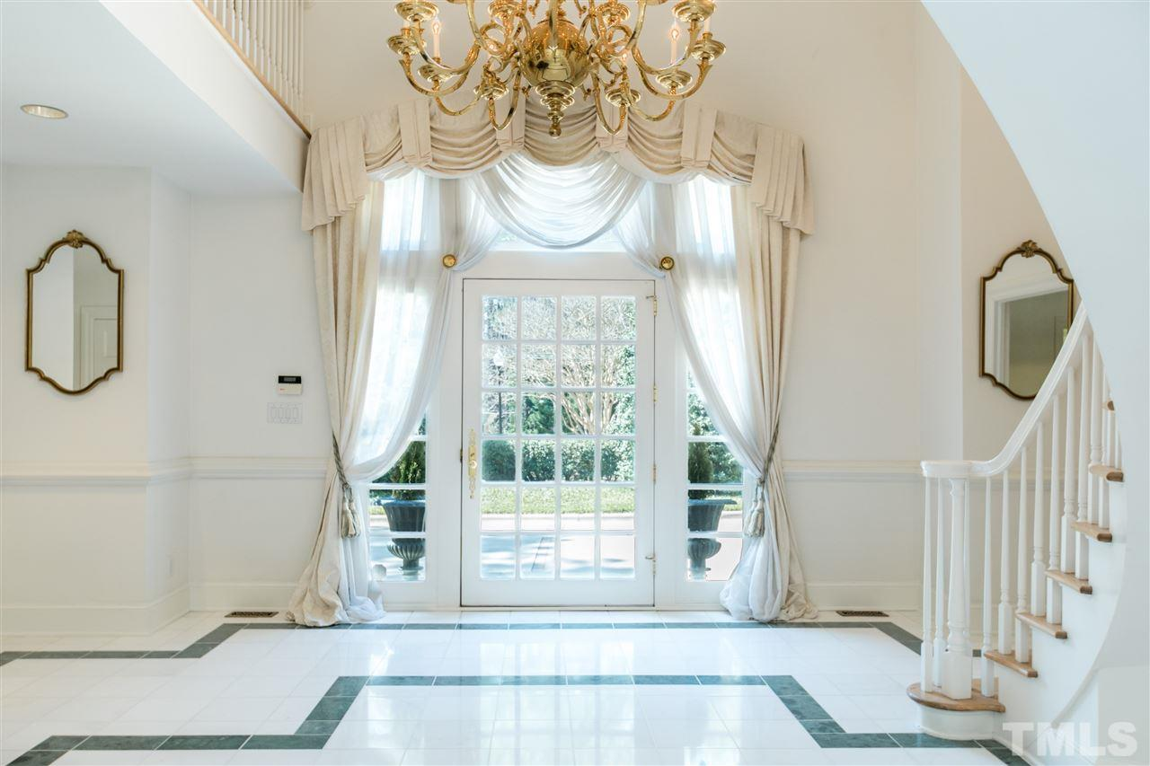 Abundant light through the oversized front door.