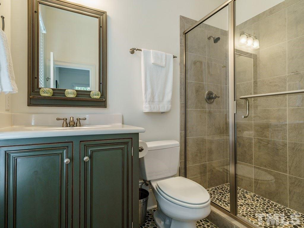 Adjoining the main floor bedroom, this bath is beautifully appointed.