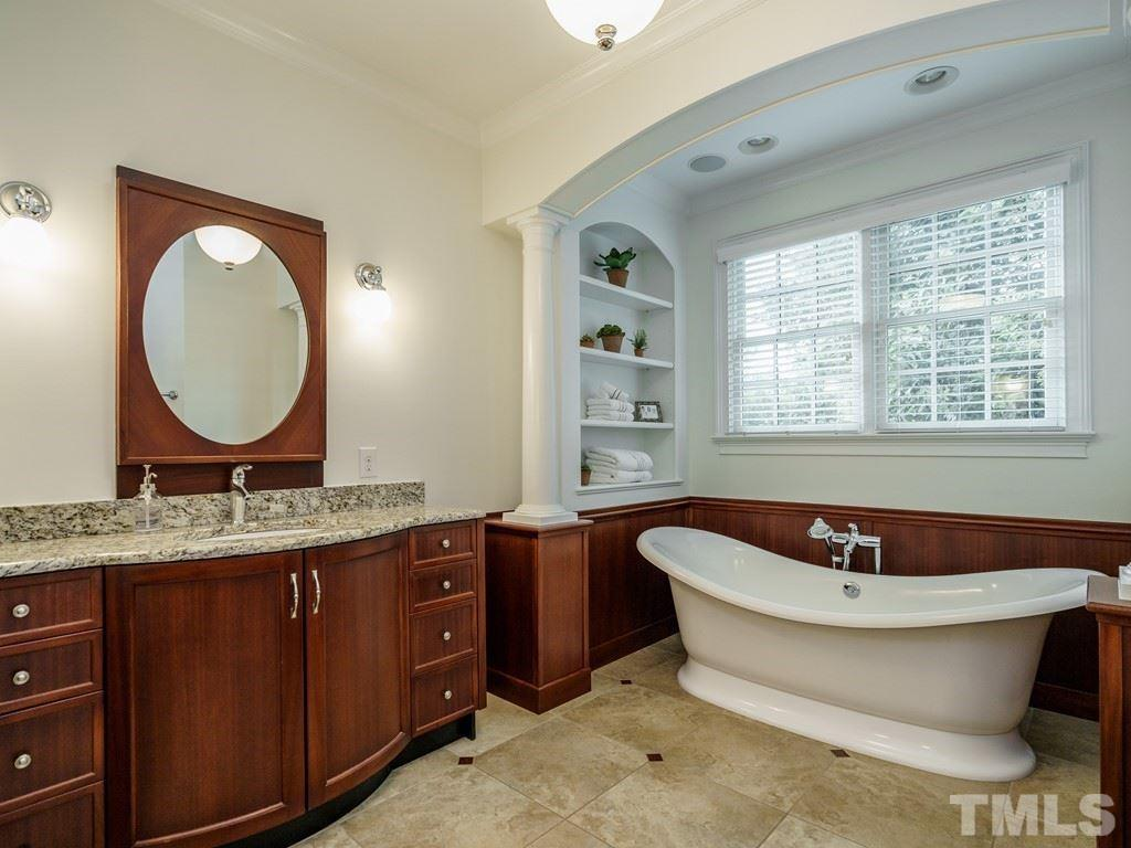 Spacious and uplifting, with TV, slipper tub, shelving, separated vanities with granite tops.  Large walk-in shower with cubbies and a bench seat.