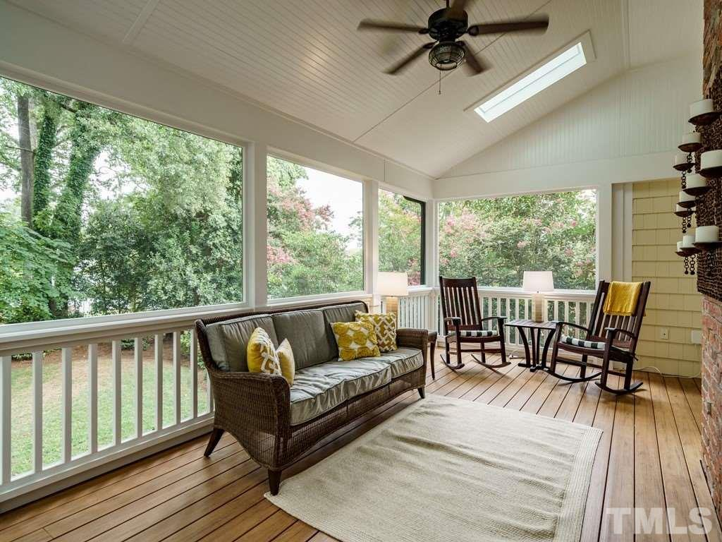 This porch is roomy and overlooks a wonderfully landscaped backyard with large hardwood trees.