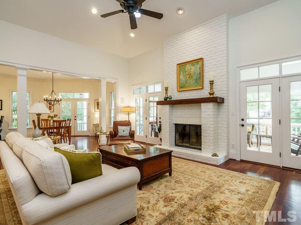 The core of the living area is an enormous family room with fireplace, vaulted ceilings and direct access to the screened porch and deck.