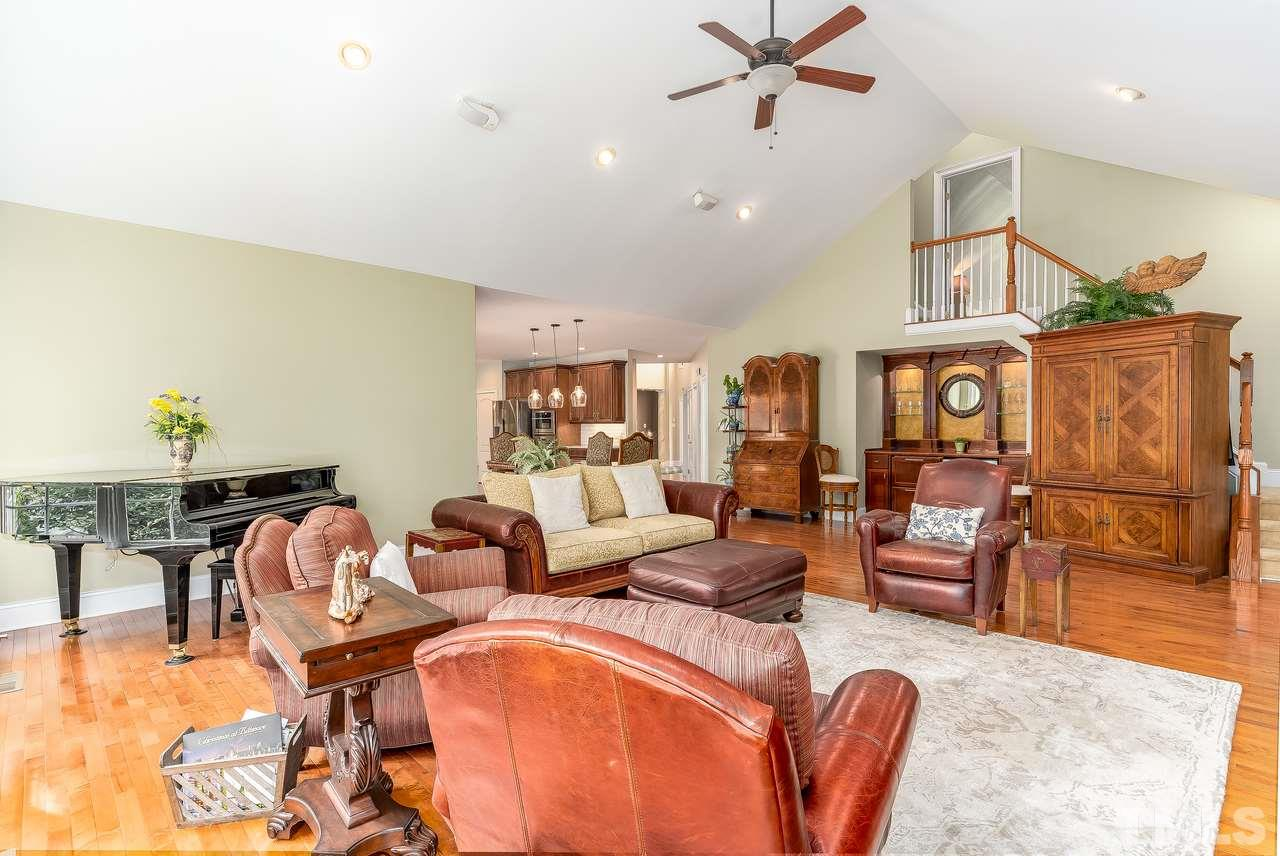 So much space in this family room with bar, guests will not want to leave!