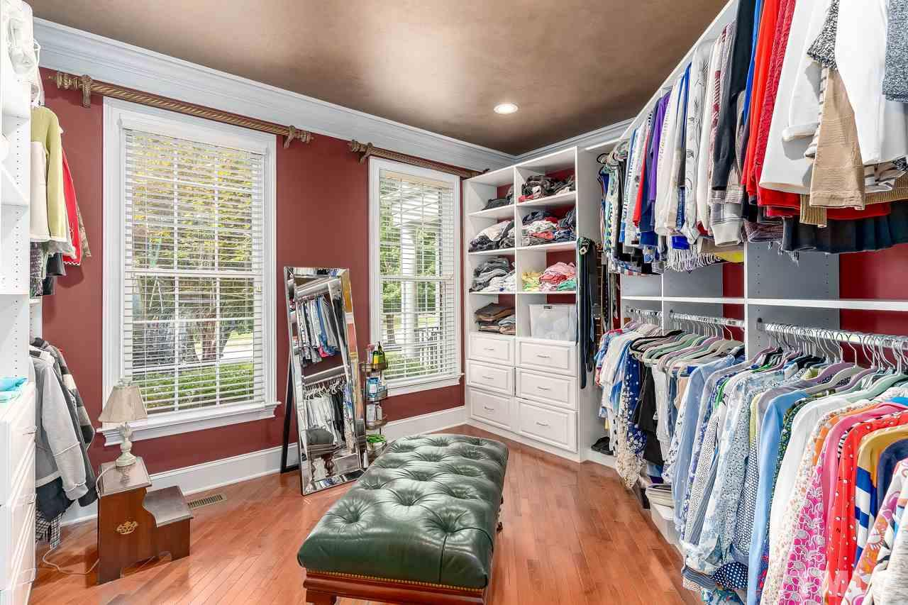 Walk-in closet in master bedroom is sure to impress anyone!