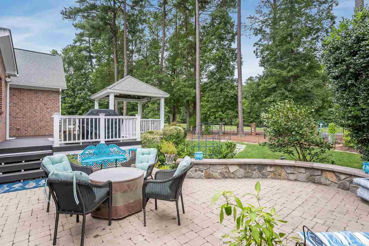 Private patio with sitting wall, ideal for entertaining family and friends.
