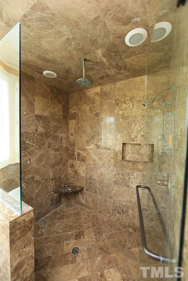 HUGE walk in shower ( there are his & hers!) with a separate soaking tub!