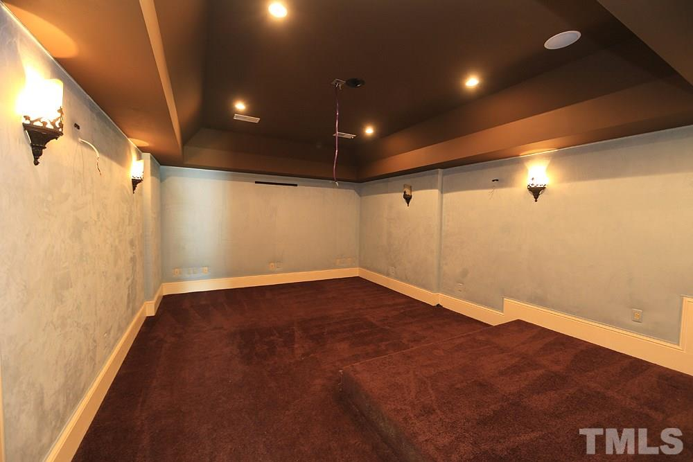 Ready for the popcorn and your favorite movies! The theater is located in the fully finished basement with full kitchen, full bath, fireplace and access to the backyard pool patio & outdoor fireplace!