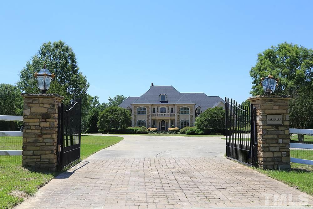 Tree lined drive takes you to 915 & 917 Ennis Rd Equestrian Estate