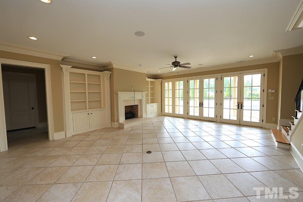 Large finished basement, fireplace, full bath and wall of french doors views the pool and patio-fully fenced backyard. Several amazing storage options here!