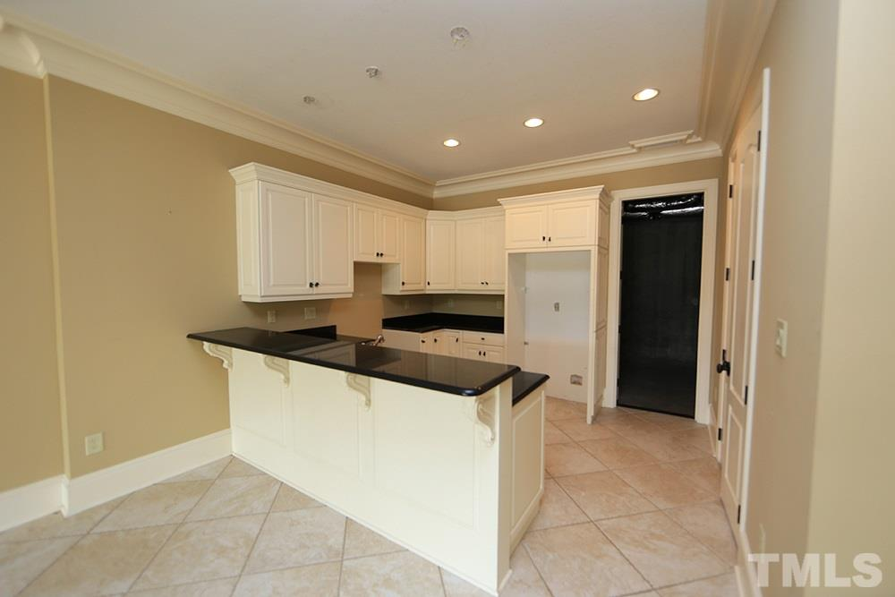 Secondary kitchen in basement allows for ease of entertaining