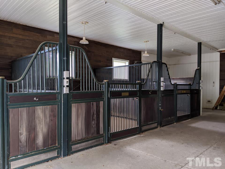 Beadboard ceilings, fans, tongue & groove stalls with brass name plates, this barn is for the discerning equestrian. Your horses will be held in comfort and style here