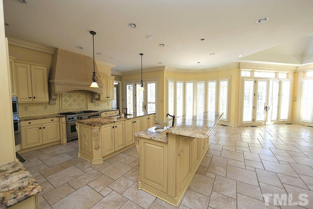 A chefs delight! Tumbled stone floors, a wall of french doors overlooks the patios/pool, built in fridge and high end appliances all add to this magnificent place to prepare meals!
