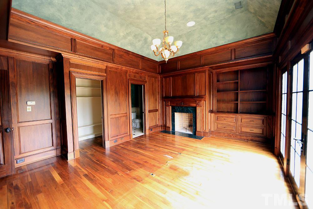 Enjoy hardwood finishes in this stunning office! Built in bookcases,fireplace all encased in hardwood! Private office features, full walk in closet, full bath, coved ceilings, balcony with french doors overlooking back pastures-incredible details!