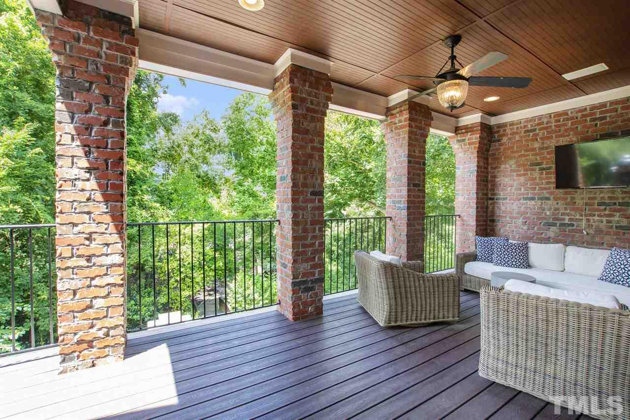 Upper level deck directly accessed from breakfast nook/kitchen/family room...for open-air grilling or covered and comfortable lounging