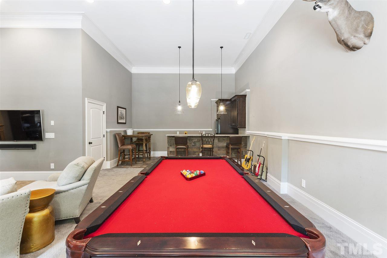 Rec Room in finished basement with wet bar, which leads to one covered patio, one open patio, and the rest of the backyard expanse