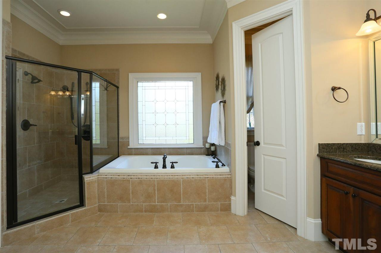 Separate tub and shower, tile floor