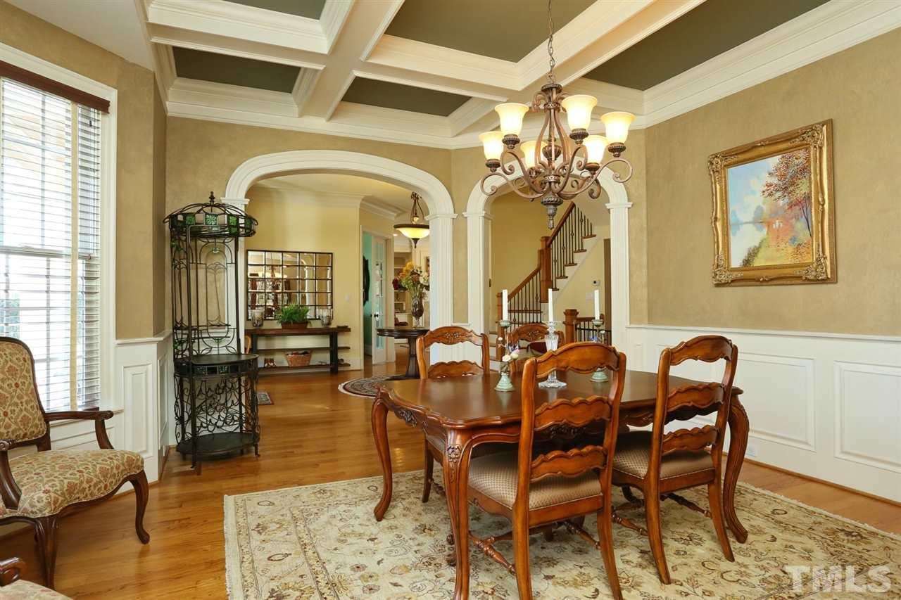 Beautiful formal dining room with coffered ceilings.  Butlers pantry leads into the kitchen